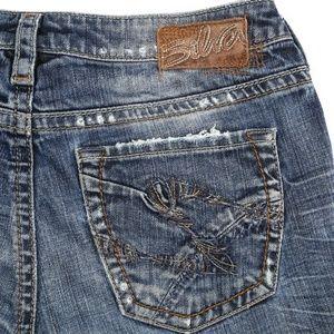 Silver Suki Flare Distressed Dark Mid Rise Jeans